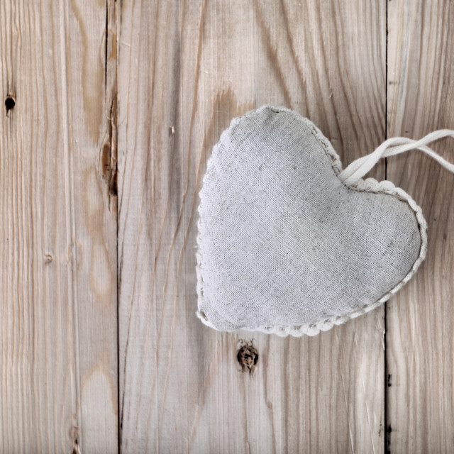 """heart-shaped pillow on plank"" stock image"