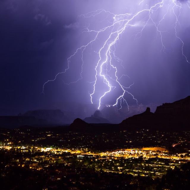"""Lightning bolts strike during a storm over Sedona, Arizona"" stock image"