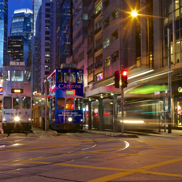 """Trams on Des Voeux Road Central, Hong Kong"" stock image"
