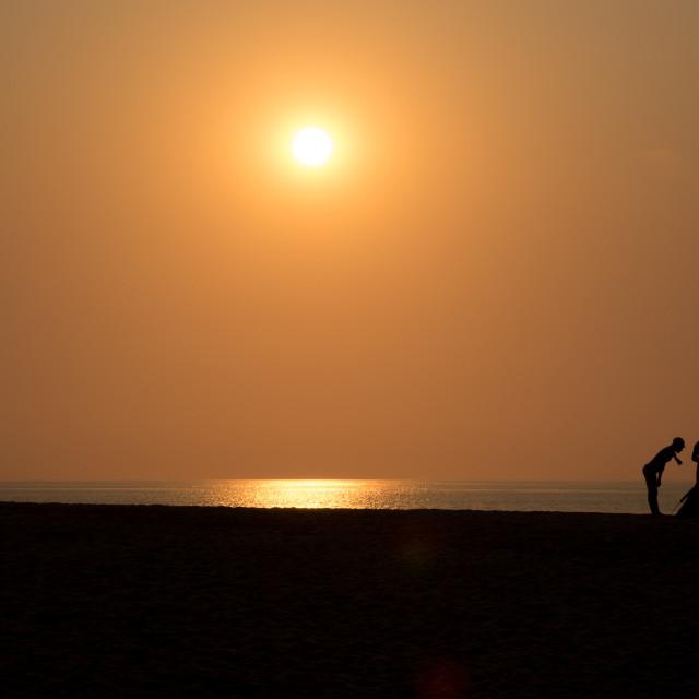 """""""Sunset on the beach, Benguela Province, Lobito, Angola"""" stock image"""
