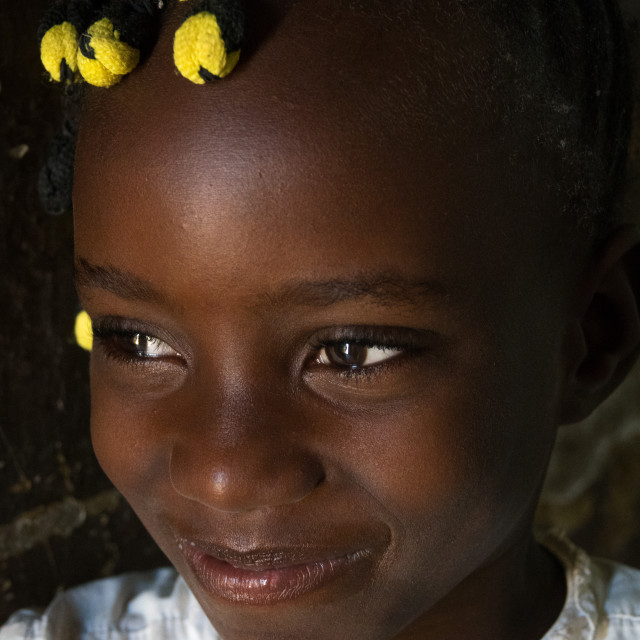 """""""Portrait of a playful girl with Angolan traditional hairstyle, Namibe..."""" stock image"""