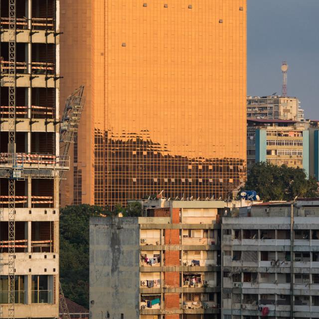"""Buildings along the Marginal promenade in Luanda city center at sunset,..."" stock image"