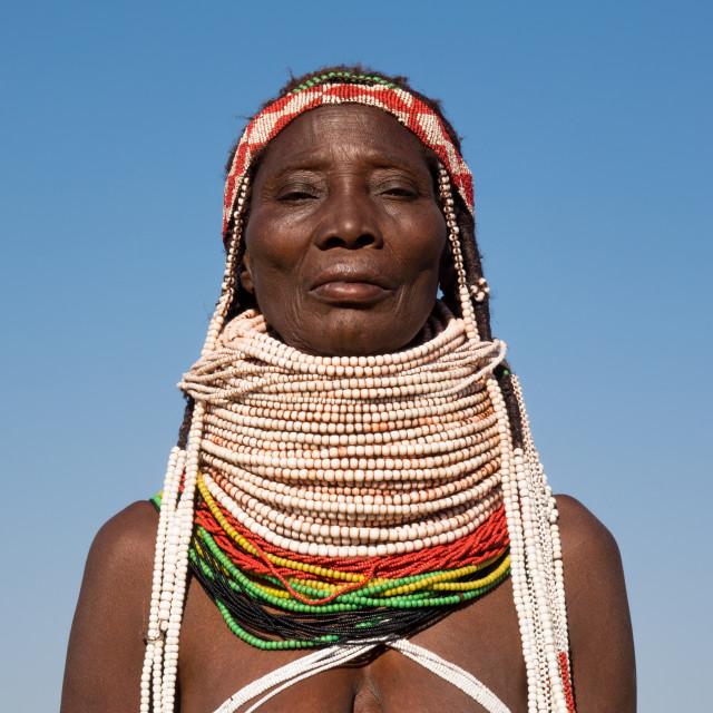 """Handa tribe woman going to the Tuesday market, Huila Province, Hoque, Angola"" stock image"