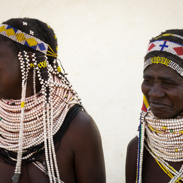 """Handa tribe women going to the Tuesday market, Huila Province, Hoque, Angola"" stock image"