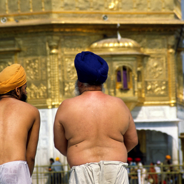 """AMRITSAR INDIA Two Sikh gentlemen bathe in the holy waters of the lake..."" stock image"