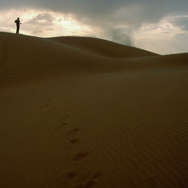 """Stock Photo of a Lone Man on a Dune"" stock image"