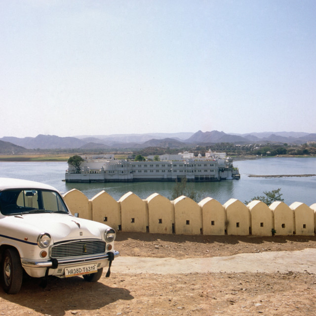 """Udaipur India Ambassador Taxi in front of the Lake Pichola and the Lake..."" stock image"