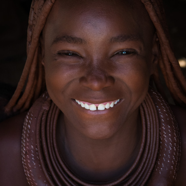 """""""Portrait of a Himba tribe young woman smiling, Cunene Province, Oncocua, Angola"""" stock image"""