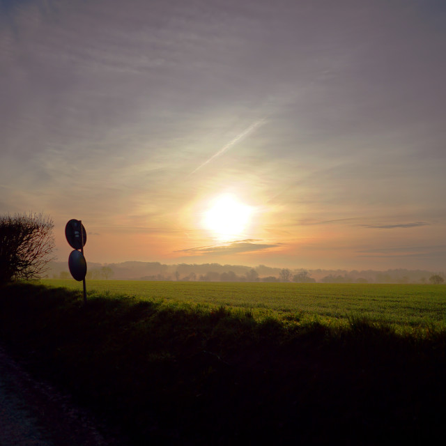 """Sunrise over the fields and country lanes"" stock image"
