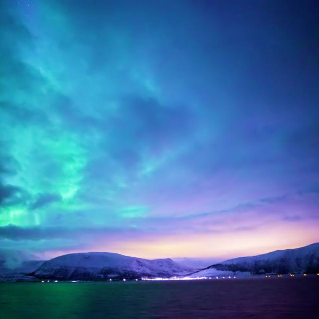 """The Northern Lights dance across the Norwegian coast"" stock image"