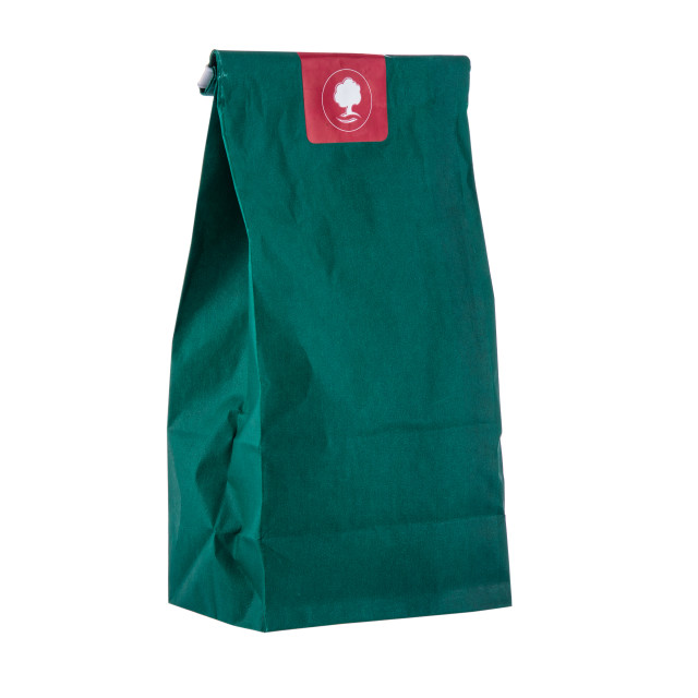 """""""Paper package, green bag with herbs for tea isolated on a white"""" stock image"""