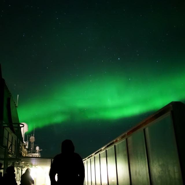 """Watching the Aurora dance from a moving ship"" stock image"