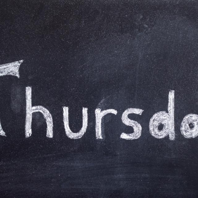 """Thursday handwritten on blackboard"" stock image"
