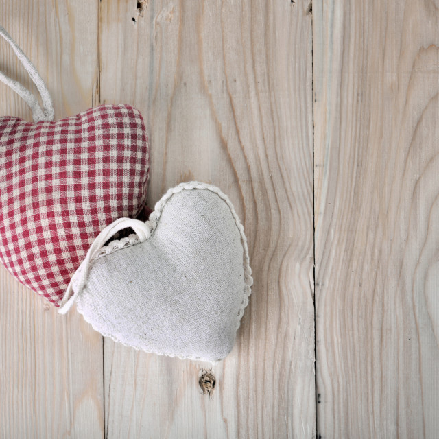 """heart-shaped pillow on a plank"" stock image"