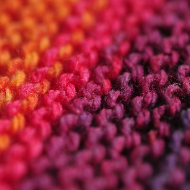 """Close up of seamless knitted diagonal patterns in vivid rainbow"" stock image"