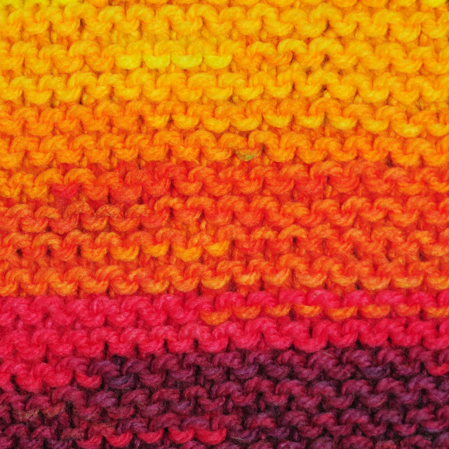 """Fragment of handmade seamless knitted patterns in rainbow colors"" stock image"