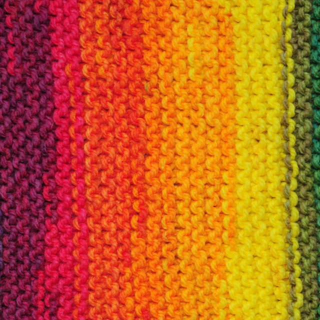 """Handmade rainbow colored seamless knitted patterns texture with"" stock image"