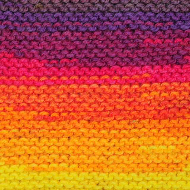 """Fragment of handmade seamless knitted patterns in rainbow sunset"" stock image"