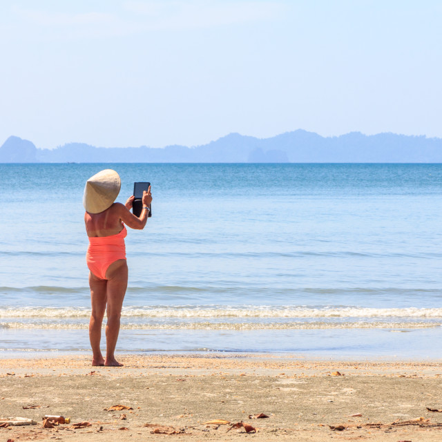 """Woman taking photo on Ipad"" stock image"
