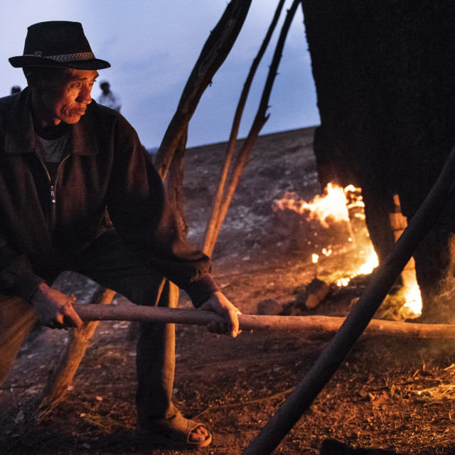 """Brick workers firing a kiln near Antsirabe, Vakinankaratra Region, Madagascar"" stock image"