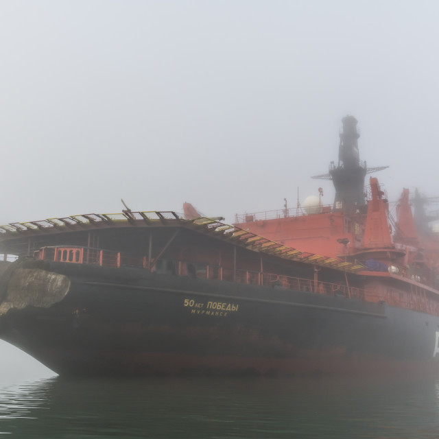 """Icebreaker in the fog anchoring in Tikhaya bay on Hooker island, Franz Josef..."" stock image"
