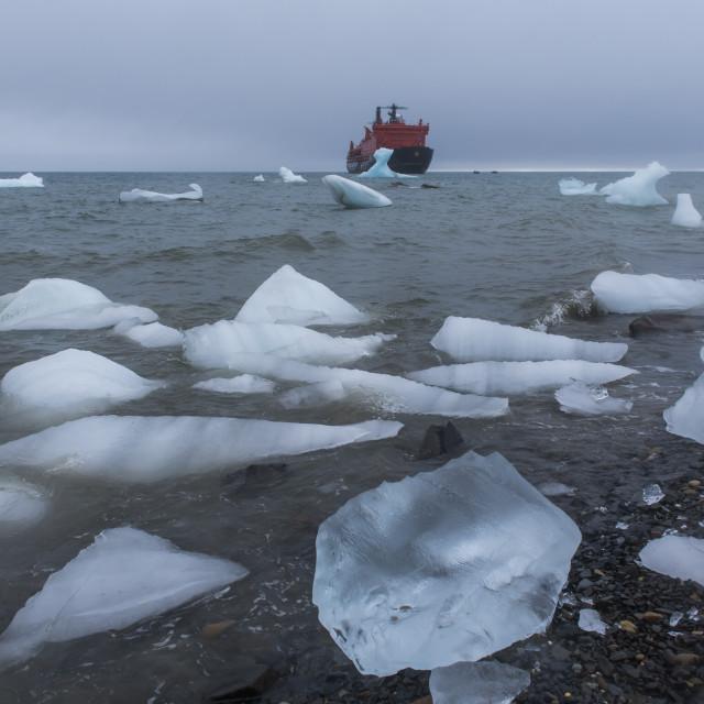 """Icebreaker anchoring behind a iceberg, Champ Island, Franz Josef Land..."" stock image"