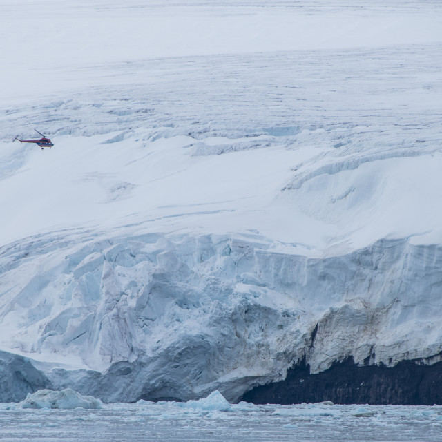 """""""Helicopter flying over the giant icefield of Alexandra Land, Franz Josef Land..."""" stock image"""