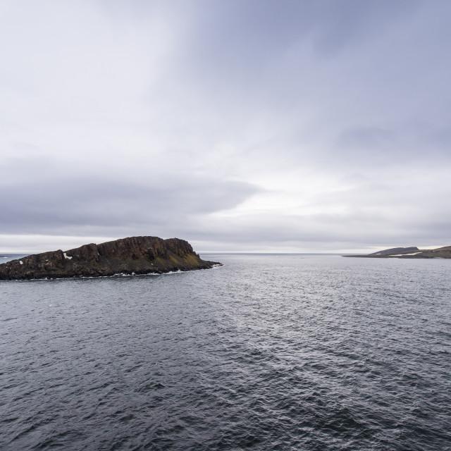 """Moody lights over Cape Trieste, Franz Josef Land archipelago, Russia"" stock image"
