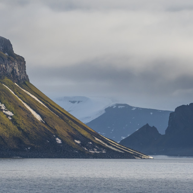 """""""Green cliff in the glacier covered moutains of Franz Josef Land archipelago,..."""" stock image"""