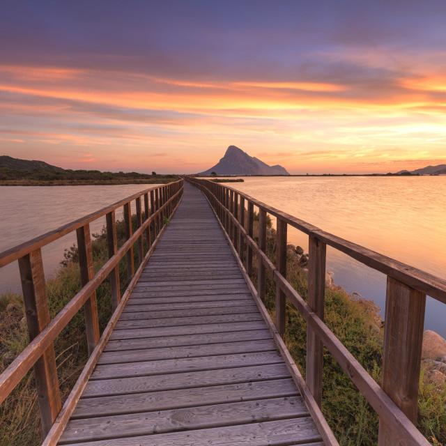 """Sunrise from a pedestrian walkway. Porto Taverna, Loiri Porto San Paolo,..."" stock image"
