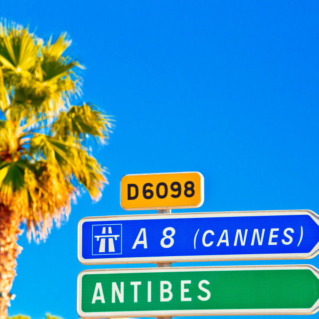 """Cote d Azur road sign to Antibes and Cannes"" stock image"