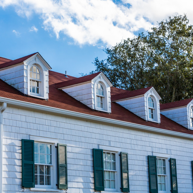 """Dormers on Coastal Cottage"" stock image"