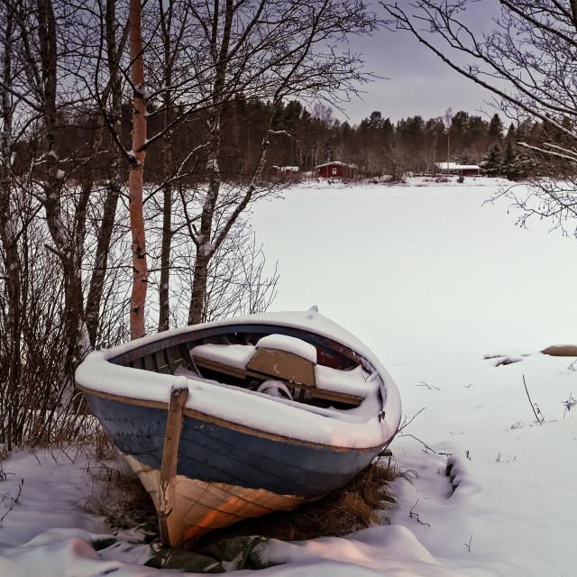 """Fishing Boat Under Snow"" stock image"