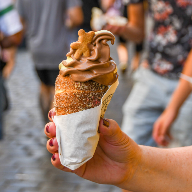 """A trdelník chimney, which is a cinnamon pastry filled with soft serve ice cream"" stock image"