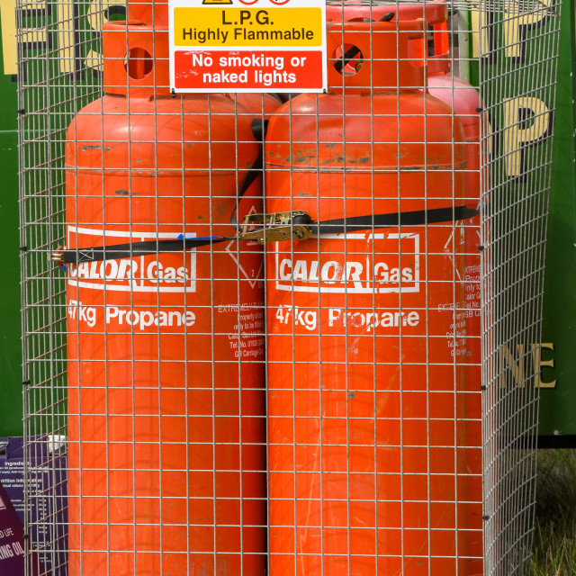 """Pair of propane gas bottles locked in a metal cage"" stock image"