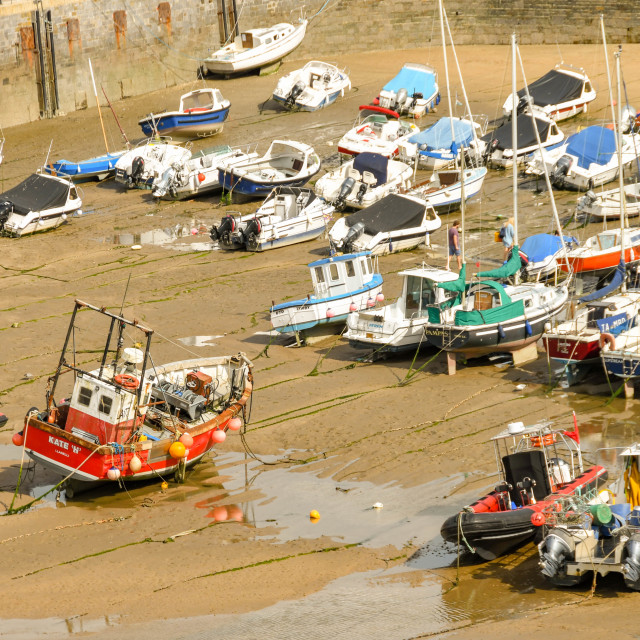 """""""The harbour in Tenby, Wales, at low tide."""" stock image"""