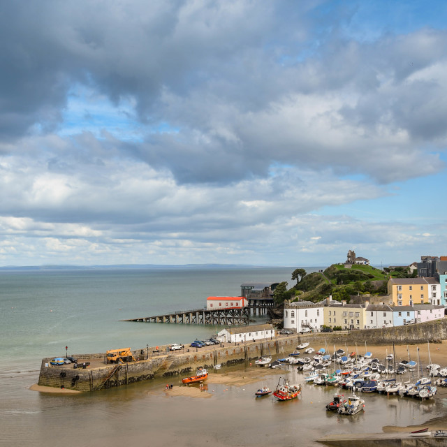 """""""The harbour in Tenby, Wales, as the tide is coming in."""" stock image"""