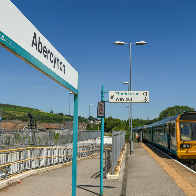 """Railway station and train in Abercynon, Wales"" stock image"