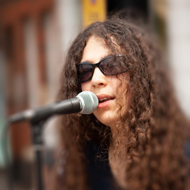 """""""Street Singer"""" stock image"""