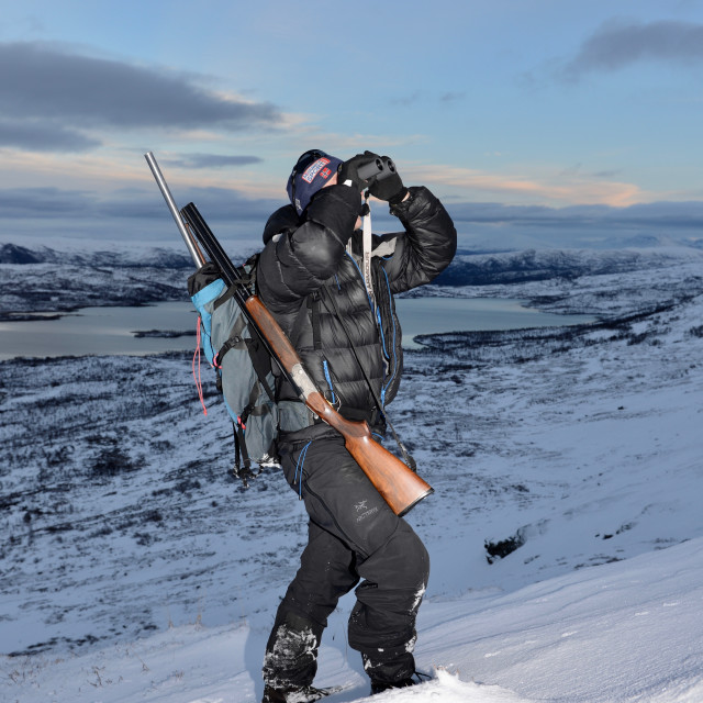 """Grouse hunter in the snow"" stock image"