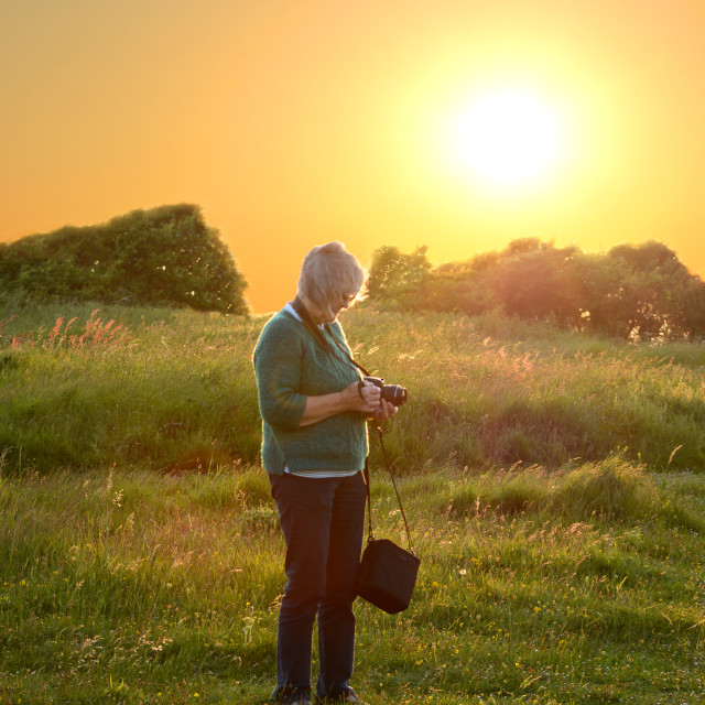 """""""Photographing the Evening Sunset"""" stock image"""