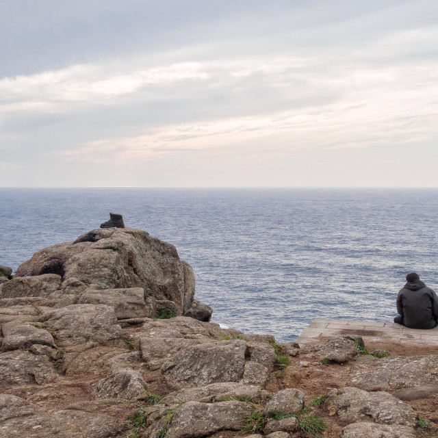 """""""A pilgrim and a boot - Cape Finisterre"""" stock image"""