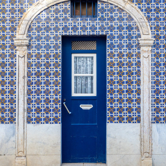 """Lisbon house door with azulejos tiles"" stock image"