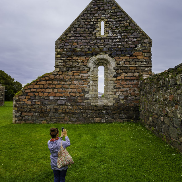 """""""Woman Taking a Photo of the Iona Nunnery"""" stock image"""