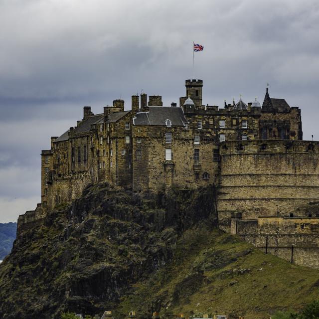 """Historic Edinburgh Castle on a Cloudy Day"" stock image"