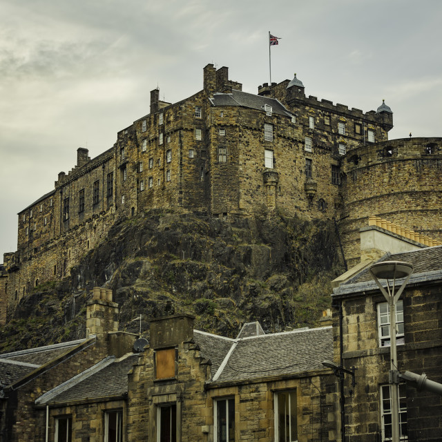 """""""Historic Edinburgh Castle Perched on a Cliff Above the City"""" stock image"""