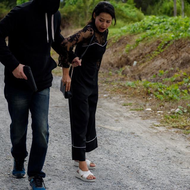 """Thief pull female handbag from behind"" stock image"