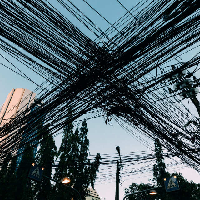 """out of focus, Messy electrical cables in India. Uncovered optical fiber technology open air outdoors in Asian cities"" stock image"