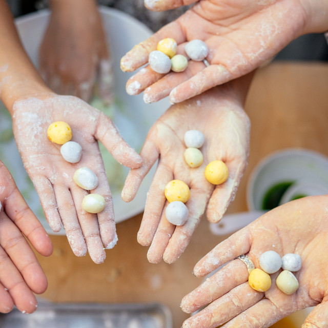 """""""Hands holding Rice Flour Balls (Bua Loy Sam See)"""" stock image"""