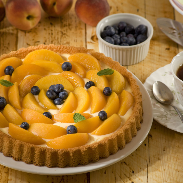"""Peach flan with blueberries"" stock image"